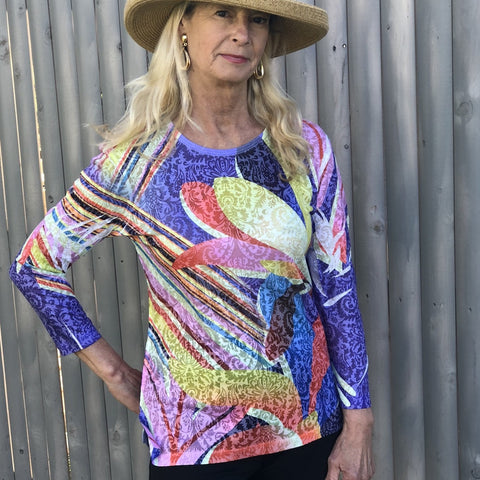 Very light and comfortable bright t-shirt with a high low and a round neck cut with a slit on each side for added comfort.  Polyester/Rayon Blend  Machine Wash Cold by two b's accessories