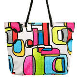 "This Fun Tote by Dolcezza is inspired from the art of California artist Irena Orlov ""Vibrant Colorful Abstract"" . A great fashion statement. The bag has an inside pocket, a full zip closure and rope handles.  Canvas Fabric   13""H x  18""W  X 5 "" D by two b'a accessories"