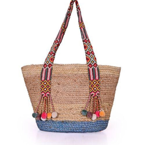 "Start your day at the beach with this colorful jute tote.  Dual top handles, fun pompoms,  open top.  100% Jute  21""W x 12""H x %""D twobsaccessories"
