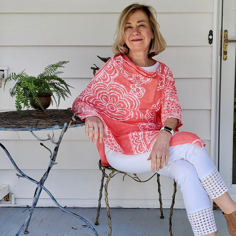two bs accessories whimsy rose grace coral ponchoThis beautiful poncho dresses up any outfit in summer.  Easily fold in a bag or luggage for convenience and doesn't wrinkle.  95% Polyester, 5% Spandex  Cold water wash.  Made in America