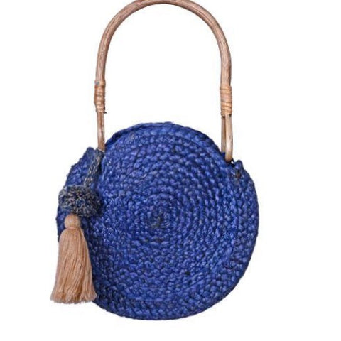 Set off for a day in the sun or in town with this tassel detail jute tote. - Wooden top handle - Open top - Exterior features tassel