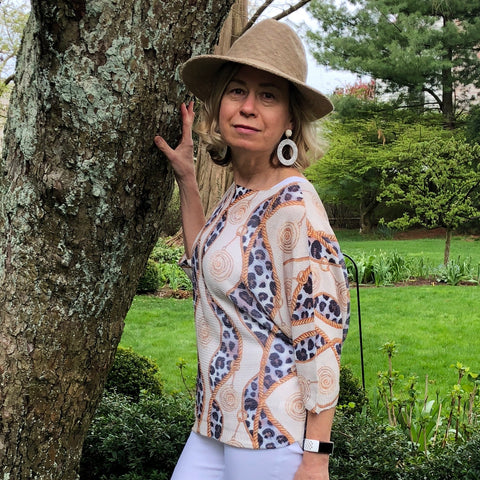 Italian Animal Print Links Top  - One Size This Italian made chenille top is a definite statement on any summer pants. Light and versatile, it will dress up your outfit.  One Size fits All  Polyester, Viscose, Elastane Blend
