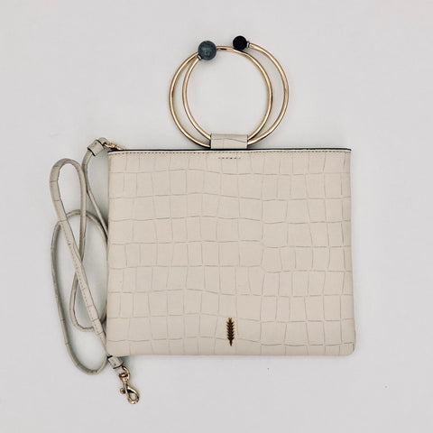 "Ivory Le Pouch  embossed croco leather clutch with beaded  ring handle.  Elegant and practical when our hands are needed. It has a shoulder strap and can be used as a cross body.  Italian leather  10""W x 8""H by two b's accessories  and thacker"