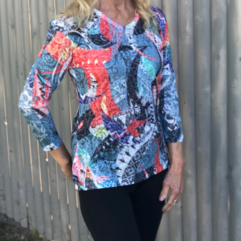 Light 3/4 Sleeve High Low Cut Black and Coral T-Shirt Very light and comfortable bright t-shirt with a high low and a round neck cut with a slit on each side for added comfort.  Polyester/Rayon Blend  Machine Wash Cold by Two B's Accessories