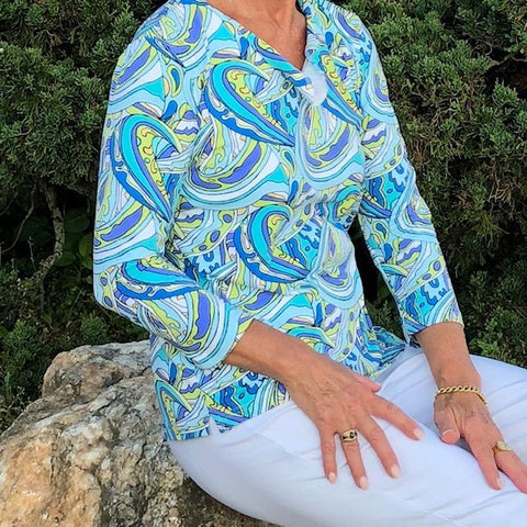 Comfortable 3/4 sleeve top with a colorful pattern.  Perfect over white pants or shorts. Preshrunk.  UPF 50