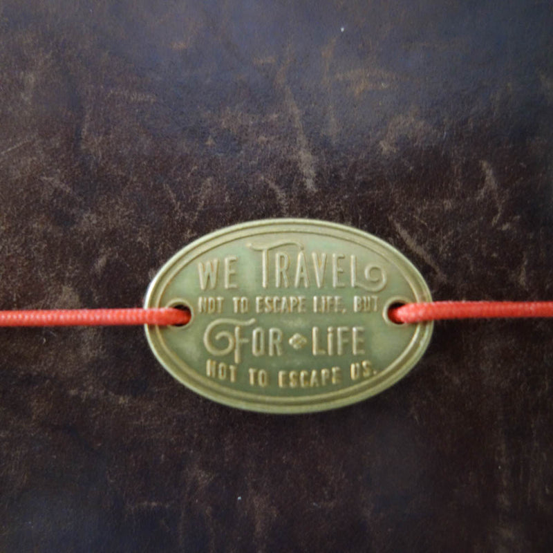 """Travel for Life"" brass plate"