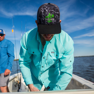 sportsman spooler long sleeve button down fishing shirt light blue and black camo mesh snapback hat