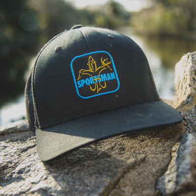 Sportsman Pitch Black Snapback Hat - mesh back black snapback - highlighter yellow deer, duck, fish fleur-de-lis with light blue text through logo