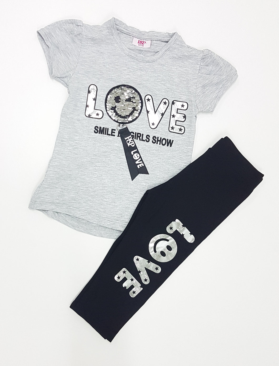 Grey top with silver smiley face and black trouser