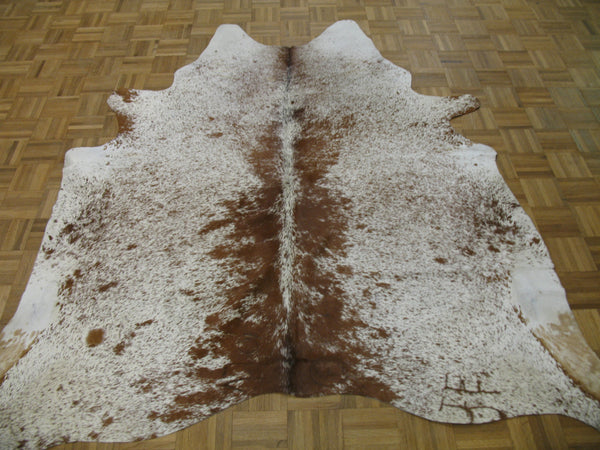 Chestnut & White cowhide - Tinnin Imports