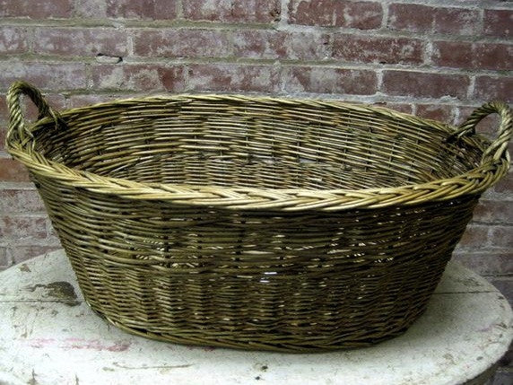 Handwoven of natural reed oval market basket with two handles
