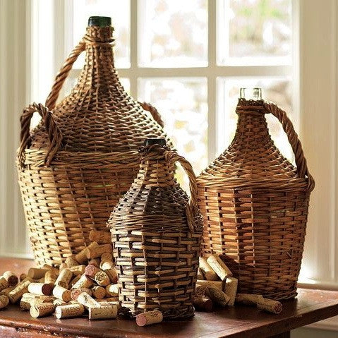 Vintage european wine bottles wrapped in wicker
