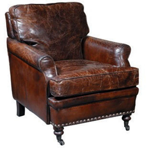 Top grain leather norfolk chair with the weathered look for an antique patina
