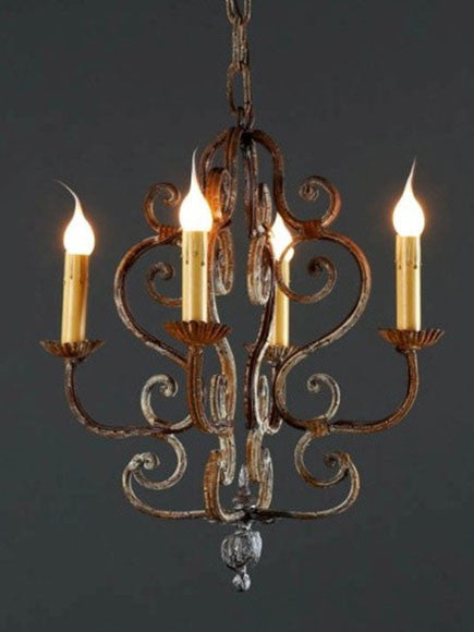 Petite chandelier of rustic iron with four lights in the tradition of Southern France and Northern Italy