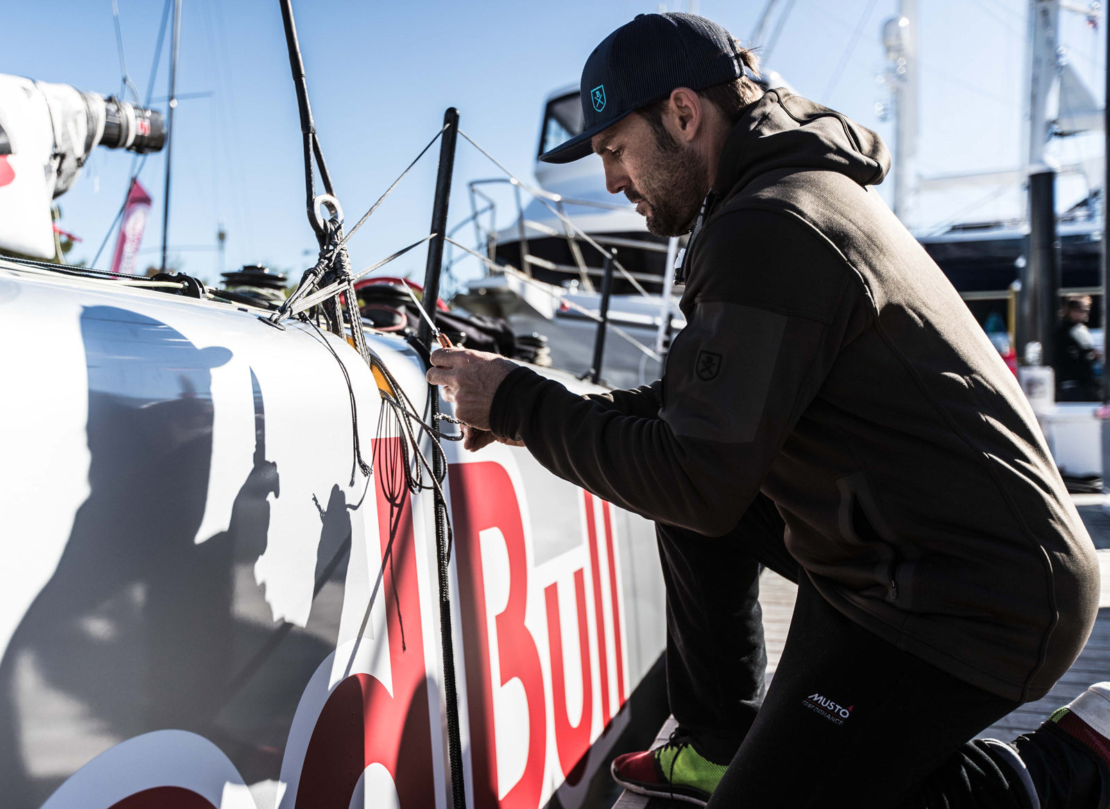 Pro Sailor Boat Preparation in The Kula Windpro Hoodie Newport Red Bull Foiling Catamaran
