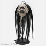 Shrunken Head on Stand In Dome