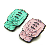 Stay Strange Enamel Pin
