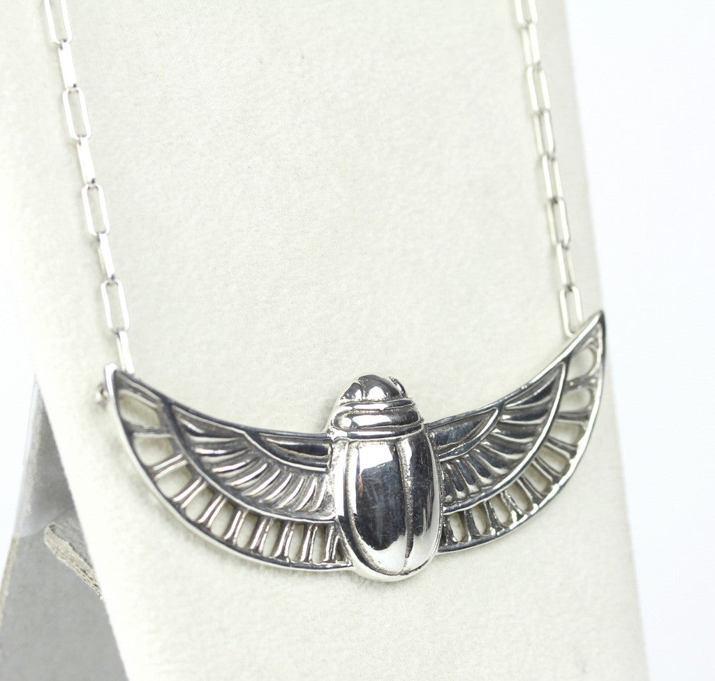 disk jewellery winged burgers jean small products egyptian pendant