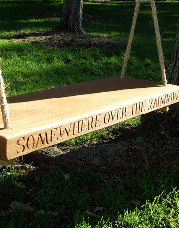 CARVED WOODEN SWING