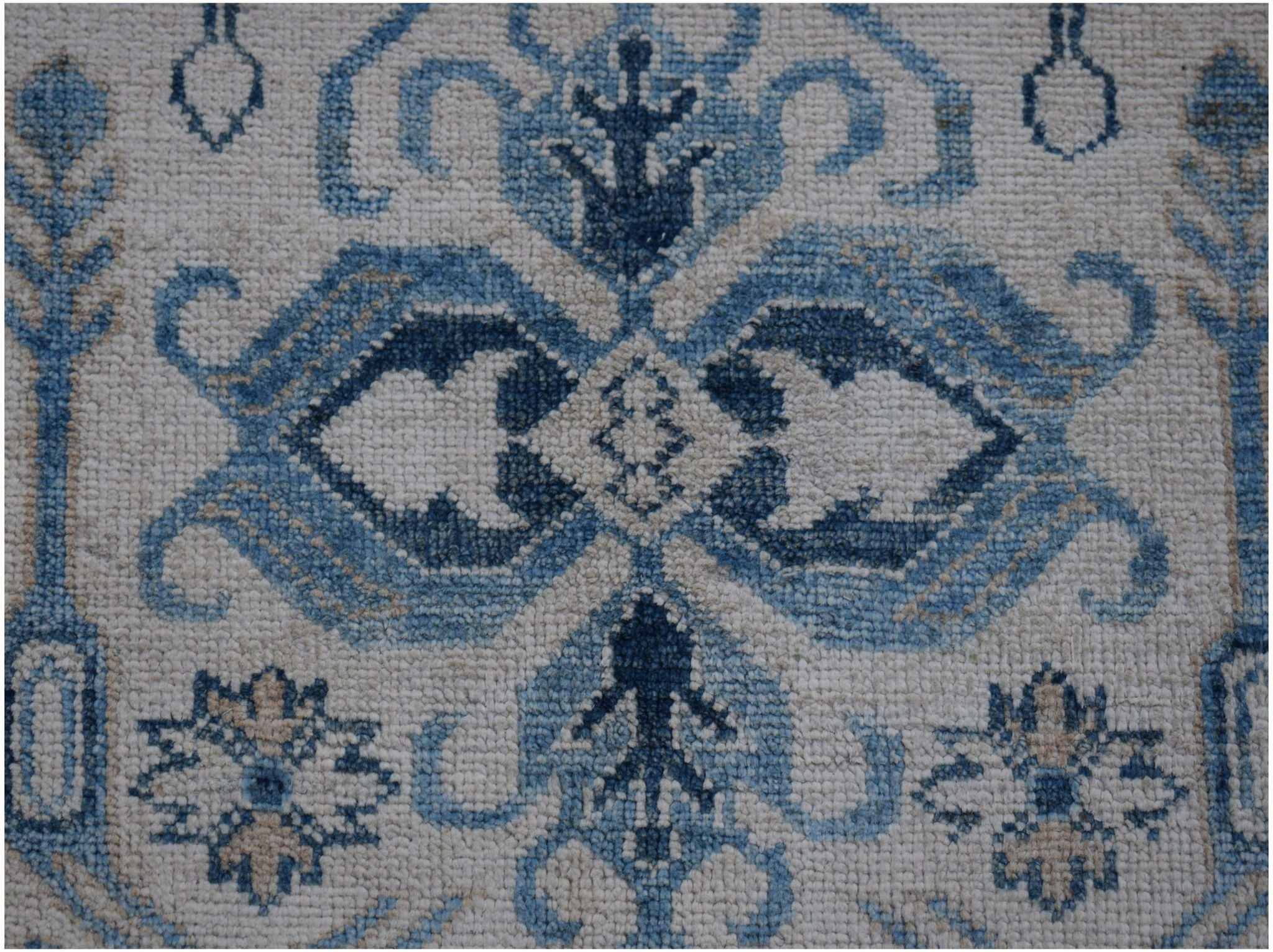 Authentic Hallway Runner Made in Afghanistan. Striking blue colours on a handknotted rug. Available online or in our Melbourne showroom