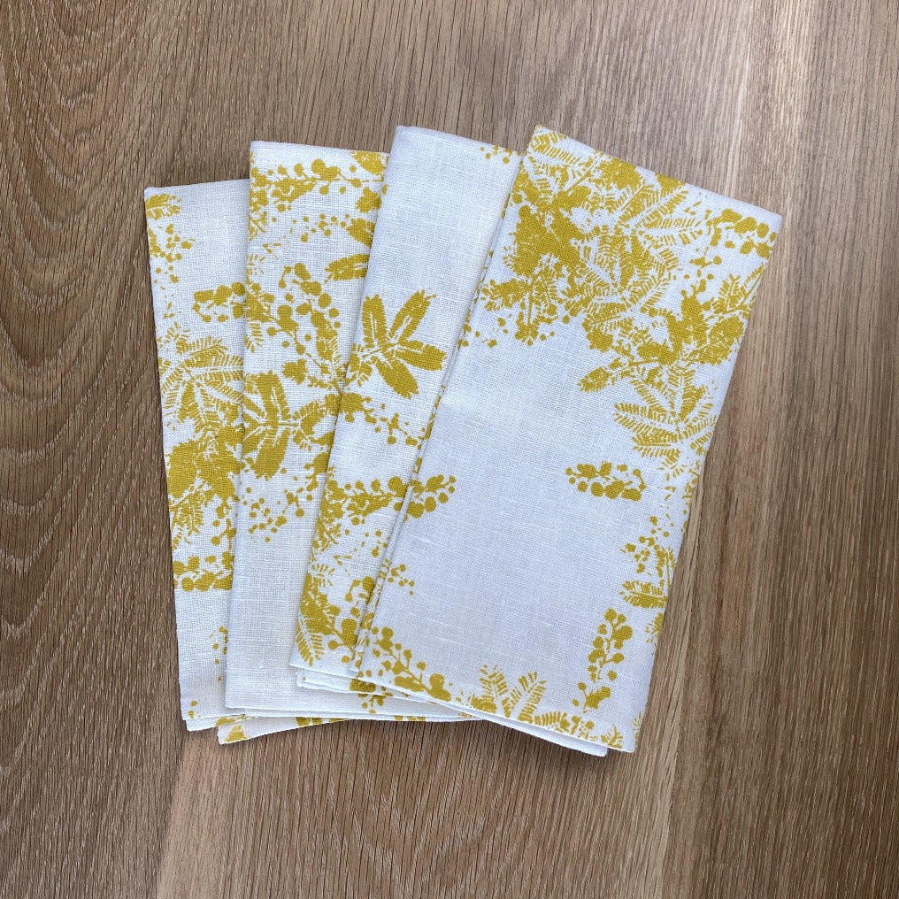 Set of Four Natural Linen Napkins with wattle print in yellow, hand screen printed in Melbourne
