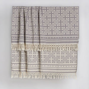 Traditional Jacquard Throw with a geometric pattern and fringed edge detail in a beautiful soft grey and cream tone made from 100% Turkish Cotton