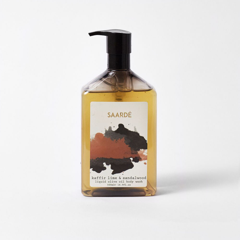 Kaffir Lime and Sandalwood Liquid Olive Oil Body Wash is packaged beautifully in a smoked pump bottle with artistic labels.