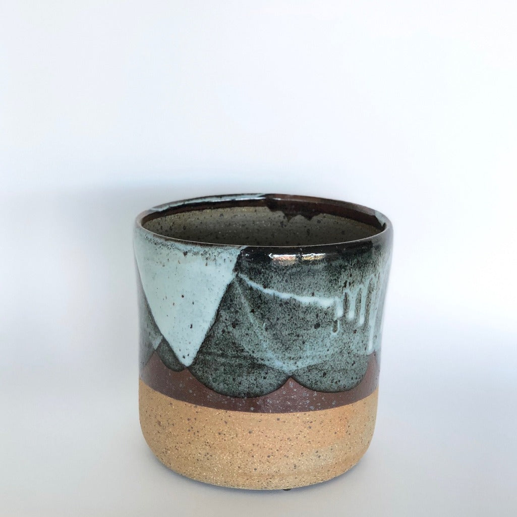 Made in Melbourne the stoneware Bloc Chun Planter features a rustic base with contrasting glaze in a one of a kind pattern in rich teal, aqua and earthy tones.