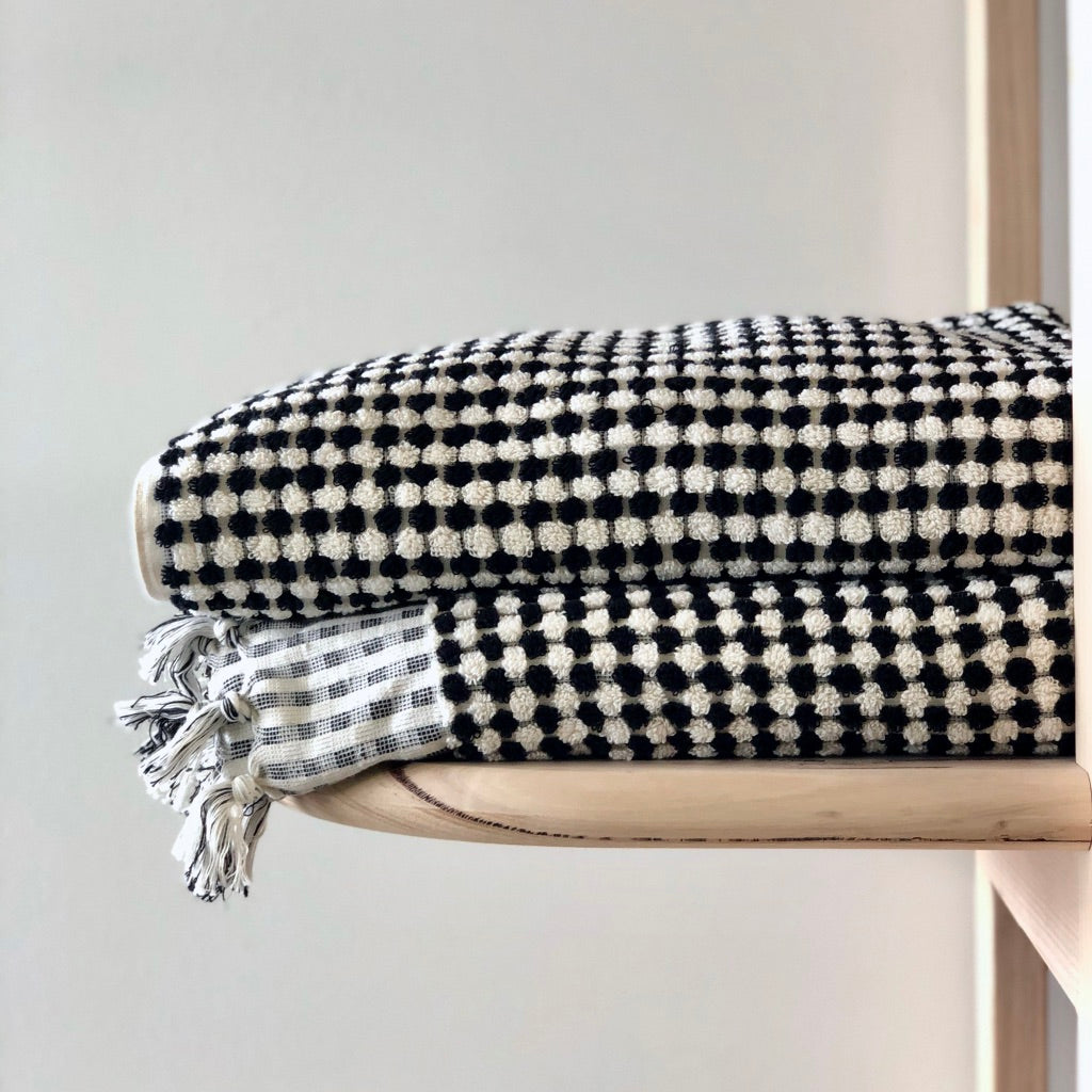 Classic luxury with our hand loomed Turkish cotton bath sheets featuring luxuriously thick pile in black and cream.