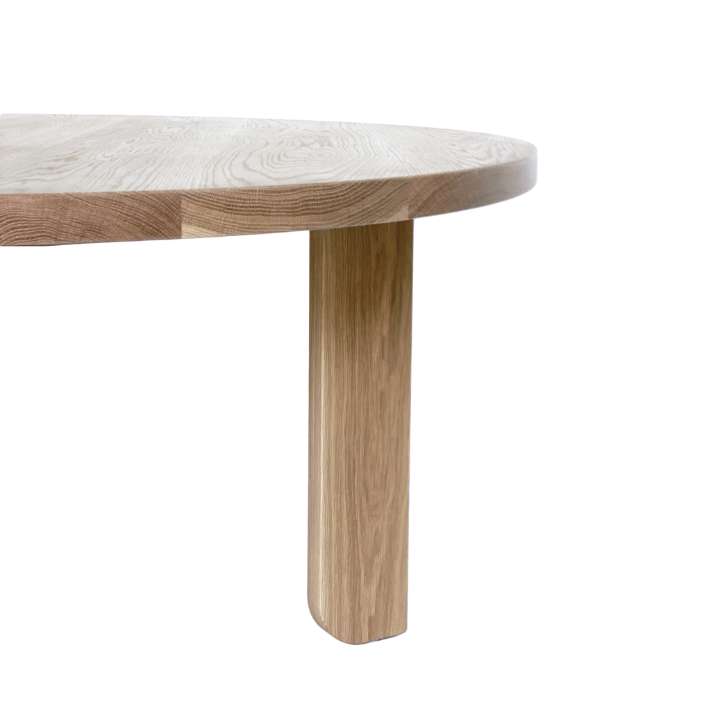 Australian Made Timber Furniture, the Lunar Round Dining Table in Solid American Oak. Made in Melbourne, the Lunar Round Dining Table features soft curves and half arch details to create lightness at the base of the leg. Custom sizes available.