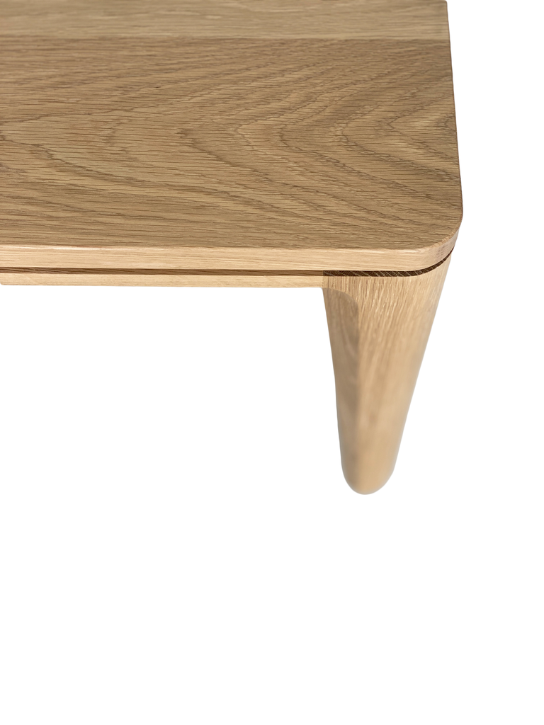 Australian Made Coffee Table in Solid American Oak Timber. Made in Melbourne, the Grace Coffee Table features subtle rounded edges contrasting with clean, straight lines and gently tapering legs.  Edit alt text
