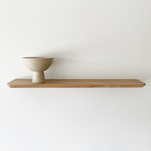 Solid timber floating shelf with bevel profile edge detail. Made in Australia and available in American Oak, Victorian Ash, Tasmanian Oak, Walnut and Tasmanian Blackwood. Custom sizes available