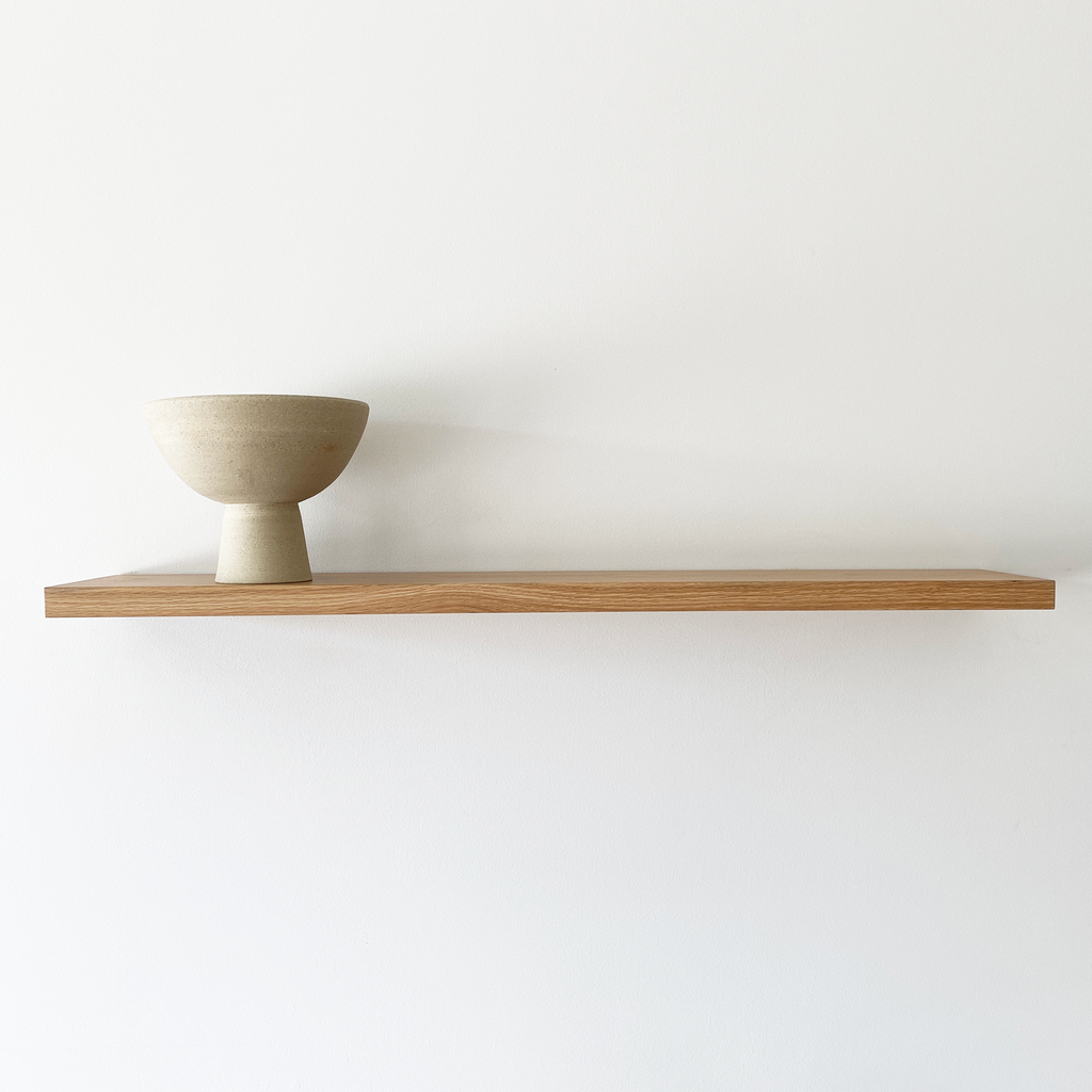 Solid timber floating shelf with straight edge detail. Made in Australia and available in American Oak, Victorian Ash, Tasmanian Oak, Walnut and Tasmanian Blackwood. Custom sizes available