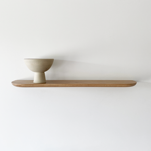Solid timber floating shelf with soft curved edge detail. Made in Australia and available in American Oak, Victorian Ash, Tasmanian Oak, Walnut and Tasmanian Blackwood. Custom sizes available