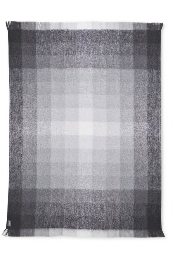 The geometric, monochromatic grey St Albans Mohair in a contemporary style with the Ridge Throw