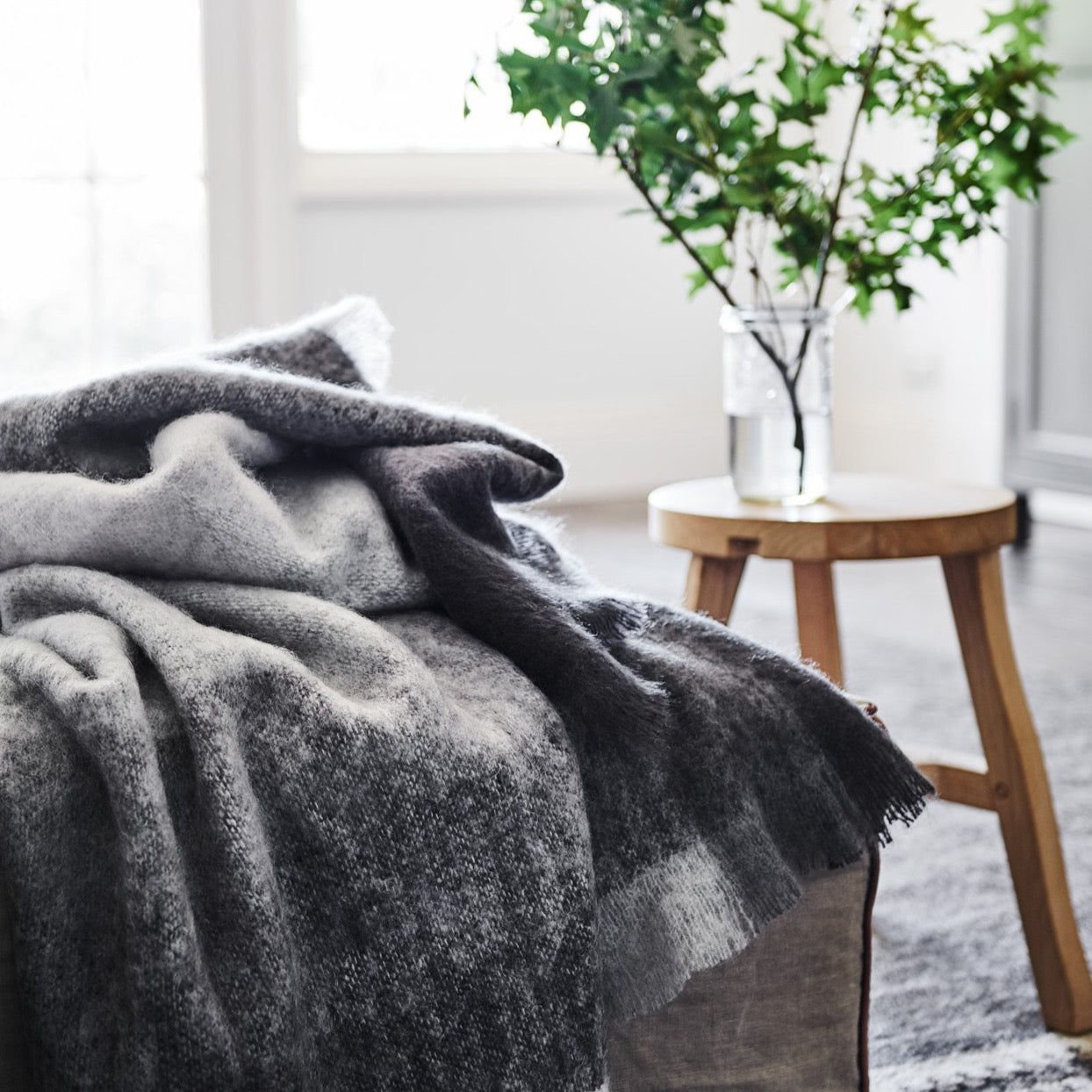St Albans Mohair throw in Ridge featuring a geometric grey pattern in contrasting shades.