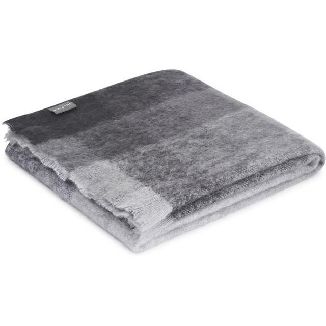 Deep charcoal greys graduate to light greys in a striking geometric pattern in the St Albans Ridge Mohair Throw.
