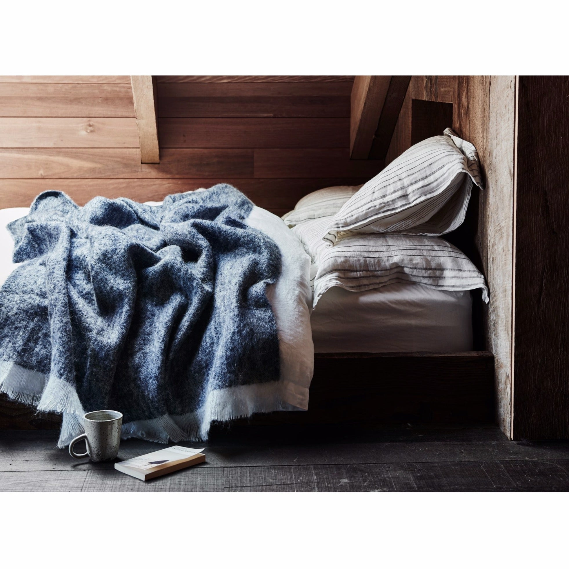 Deep blue and neutral tones provide timeless style in the St Albans Mohair throw in 'Fleet'