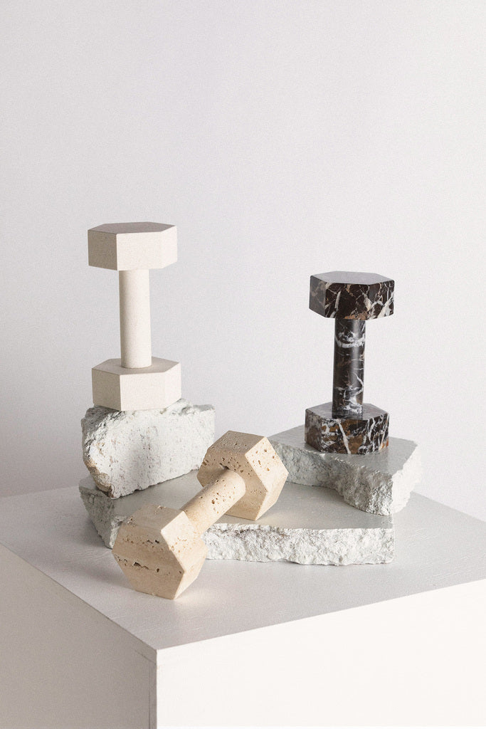 Dumbell sculpture or paperweight crafted from natural travertine stone, designed in Australia.