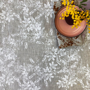 Natural Linen table cloth with white wattle pattern on off white basecloth, hand screen printed in Melbourne