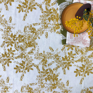 Natural Linen table cloth with yellow wattle pattern on off white basecloth, hand screen printed in Melbourne