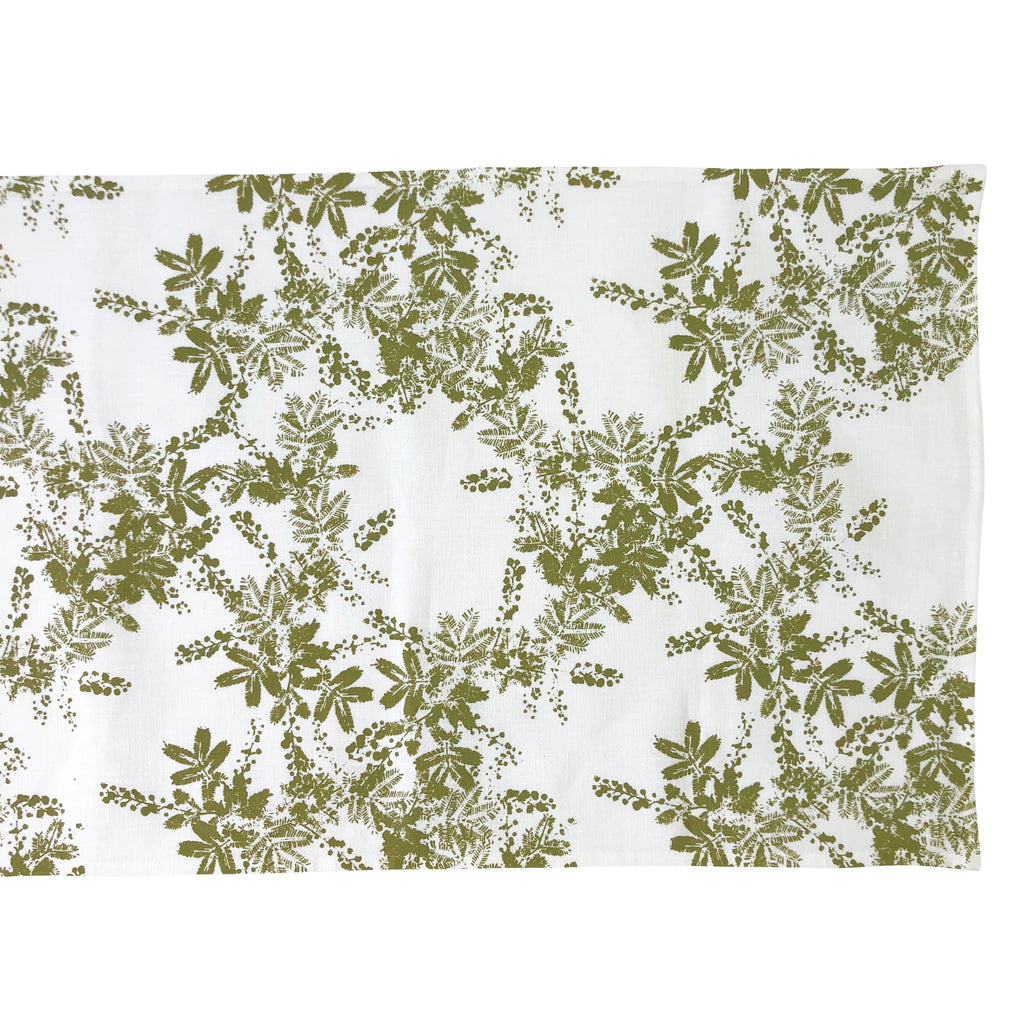 Natural Linen table runner with hand screen printed wattle pattern in green, hand screen printed in Melbourne.