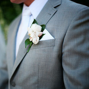 Man wearing a grey tuxedo with a boutonniere