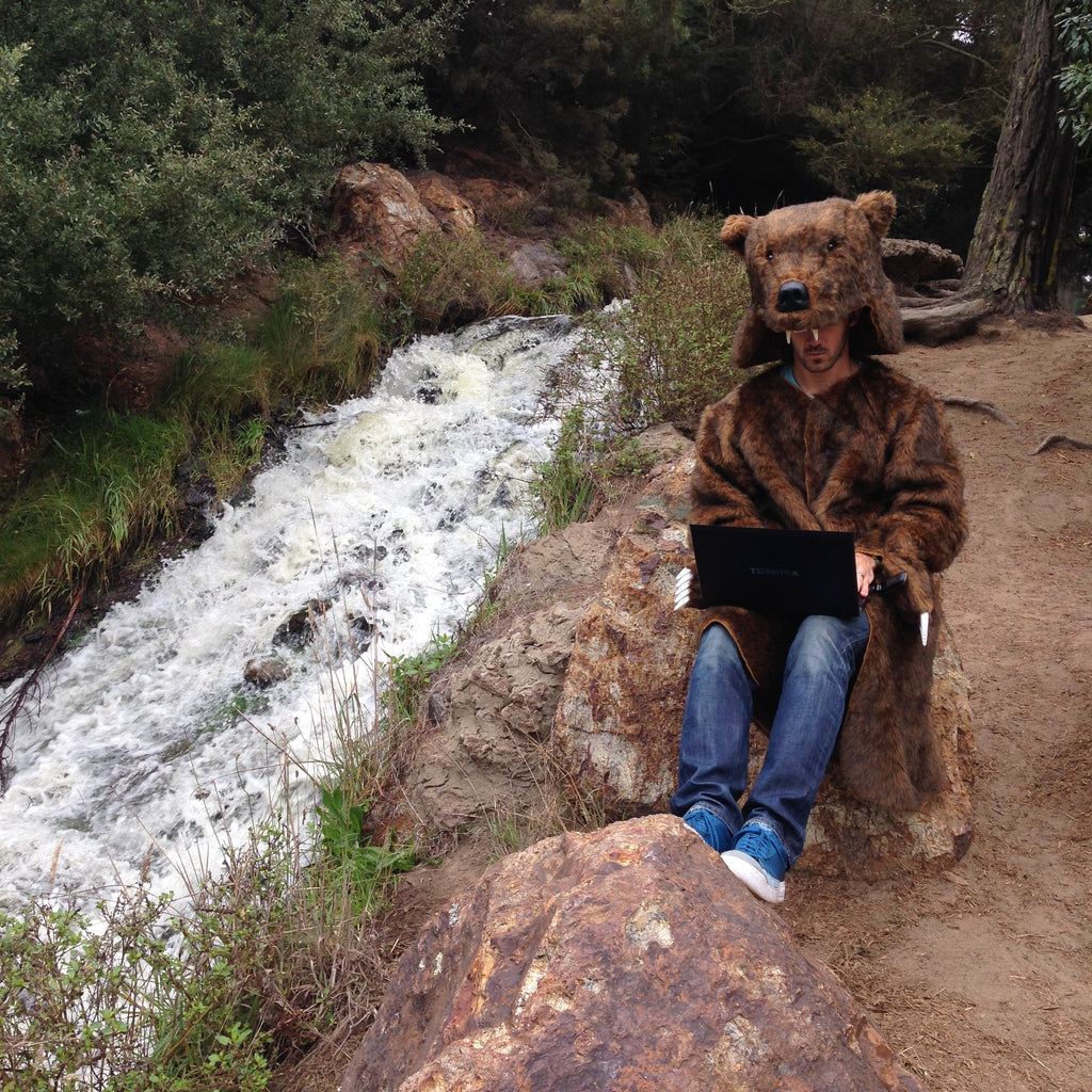 Bear sitting by the river about to unload on people's promos folders