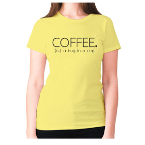 Coffee. (n.) a hug in a cup - women's premium t-shirt - Yellow / S - Graphic Gear