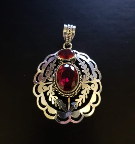 Ruby and silver pendant