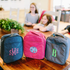monogram lunchbox in three colors.