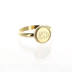 round gold ring with round braided trim