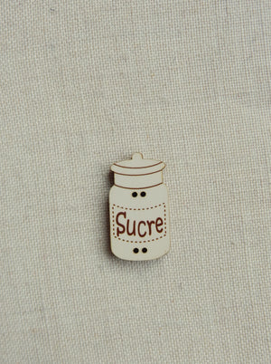 Sugar canister button