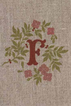 """F"" stamped on linen"